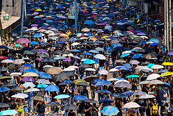 Hong Kong. 1 October 2019. Peaceful march of estimated 100,000 marchers from Causeway Bay to Central passed without trouble. Activists provoked police in the afternoon and this led to violence at various parts of the city.  Many umbrellas in crowd of marchers .Iain Masterton/Alamy Live News.
