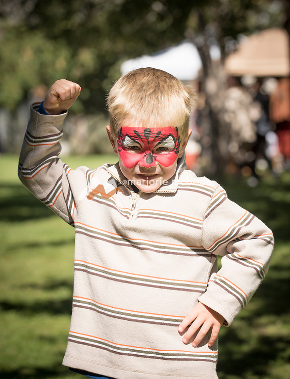 Little boy with Spider Man face paint flexing at the Thousand Springs Art Festival at Ritter Island near Hagerman, Idaho. MR