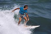 Surfer riding a wave in Caraballeda, Venezuela.