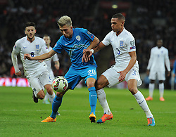Kieran Gibbs (Arsenal) puts pressure on Kevin Kampl of Slovenia  - Photo mandatory by-line: Alex James/JMP - Mobile: 07966 386802 - 15/11/2014 - SPORT - Football - London - Wembley - England v Slovenia - EURO 2016 Qualifier
