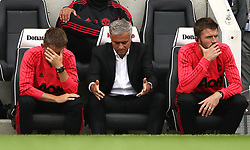 Manchester United manager Jose Mourinho (centre) appears frustrated during the game