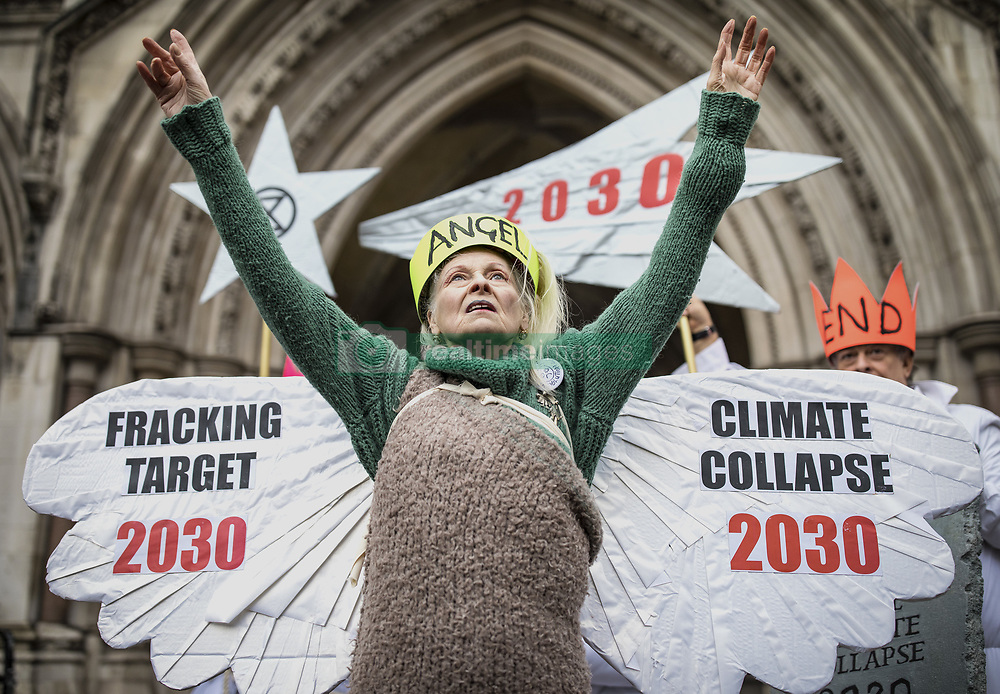 December 18, 2018 - London, London, UK - London, UK. Vivienne Westwood and climate change activists dressed as an angel, Joseph and three wise men, outside the High Court to protest against fracking policy. Campaigners will challenge new planning guidance for fracking in the High Court today. (Credit Image: © Rob Pinney/London News Pictures via ZUMA Wire)