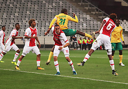 Sedwyn George challenges Nkanyiso Mngwengwe in the match between Ajax Cape Town and Golden Arrows at the Cape Town Stadium on Saturday, August 19, 2017.