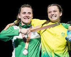 Left to right Northern Ireland's Michaela Walsh (silver) shares a joke with Australia's Skye Nicolson (gold) following the Woman's Feather (54-57kg) final at Oxenford Studios during day ten of the 2018 Commonwealth Games in the Gold Coast, Australia.