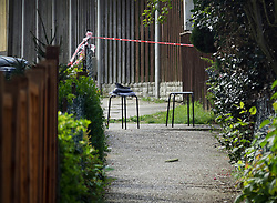 © Licensed to London News Pictures. 12/04/2017. London, UK. A policeman's hat rests on a chair at one end of an alleyway off Newnham Close where a 19 year old man, named locally as Abdullahi Tarabai,  was murdered yesterday after reportedly being chased though a housing estate in Northolt. This is the second fatal stabbing in the capital in 24 hours. The location is adjacent to a gun siege from October 2016. Four men have been arrested Photo credit: Peter Macdiarmid/LNP