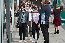 ©Licensed to London News Pictures 24/07/2020     <br /> Bromley, UK. Shoppers going into Primark in Bromley High Street, South East London today wearing face masks. A face mask or covering becomes compulsory from today when entering a petrol station, shop, train station, bank, post office or a shopping centre. The new rule is to help in the fight against coronavirus. Photo credit: Grant Falvey/LNP