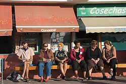 People sitting on a bench in the Canary Islands,