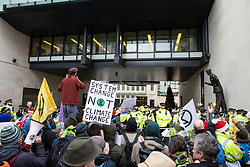 London, UK. 21st December, 2018. Environmental campaigners from Extinction Rebellion protest outside Broadcasting House against the lack of coverage by the BBC of the climate change crisis.