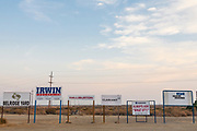 Company signs at Belridge Oil Field and hydraulic fracking site which is the fourth largest oil field in California. Kern County, San Joaquin Valley, California, USA