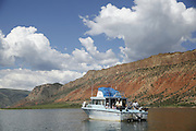 SHOT 6/8/16 10:35:43 AM - Flaming Gorge Reservoir straddles the Utah-Wyoming border and was completed in 1964. The reservoir is mainly in southwest Wyoming and partially in northeastern Utah. The northern tip of the reservoir is 10 miles southeast of Green River, Wyoming, 14 miles southwest of Rock Springs, Wyoming, and 43 miles north of Vernal, Utah. Visitors enjoy world class fishing, hiking, boating, windsurfing, camping, backpacking, cross-country skiing, and snowmobiling within Flaming Gorge National Recreation Area, which is operated by Ashley National Forest. (Photo by Marc Piscotty / © 2016)