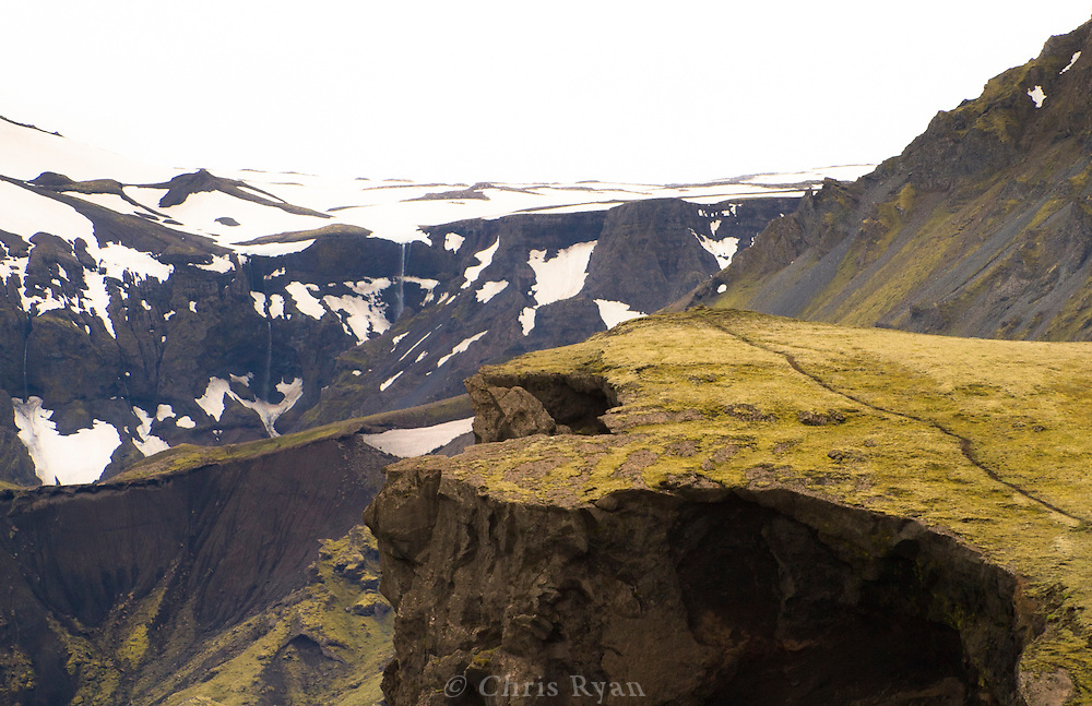 Waterfall and mountain trail in southwest Iceland