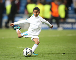 May 1, 2018 - Madrid, Spain - Cristiano Ronaldo Jr, son of Cristiano Ronaldo of Real Madrid, plays with a ball prior the UEFA Champions League, semi final, 2nd leg football match between Real Madrid and Bayern Munich on May 1, 2018 at Santiago Bernabeu stadium in Madrid, Spain  (Credit Image: © Raddad Jebarah/NurPhoto via ZUMA Press)