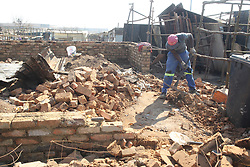 South Africa - Pretoria - 21 July 2020 - Some residents of Plastic View are building brick houses to protect their families from fires that regularly sweep through the informal settlement.<br />Picture: Jacques Naude/African News Agency(ANA)