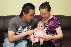 Chinese family on a sofa