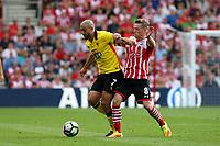 Football - 2016 / 2017 Premier League - Southampton vs. Watford<br /> Nordin Amrabat of Watford holds Southampton's Steven Davis off the ball at St Mary's Stadium Southampton <br /> <br /> Colorsport/Shaun Boggust