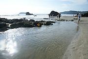 Manuel Antonio National Park, (Parque Nacional Manuel Antonio), Costa Rica Tourist explores the shore