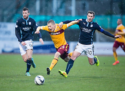 Motherwell's Henrik Ojamaa and Dundee's Kevin Thomson. <br /> Dundee 4 v 1 Motherwell, SPFL Premiership played 10/1/2015 at Dundee's home ground Dens Park.