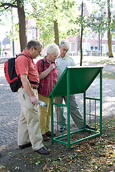 Group of older people looking at a park location map; Nottingham,