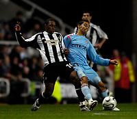 Photo: Jed Wee.<br /> Newcastle United v Celta Vigo. UEFA Cup. 23/11/2006.<br /> <br /> Newcastle's Charles N'Zogbia (L) tries to stop Celta Vigo's Nene.
