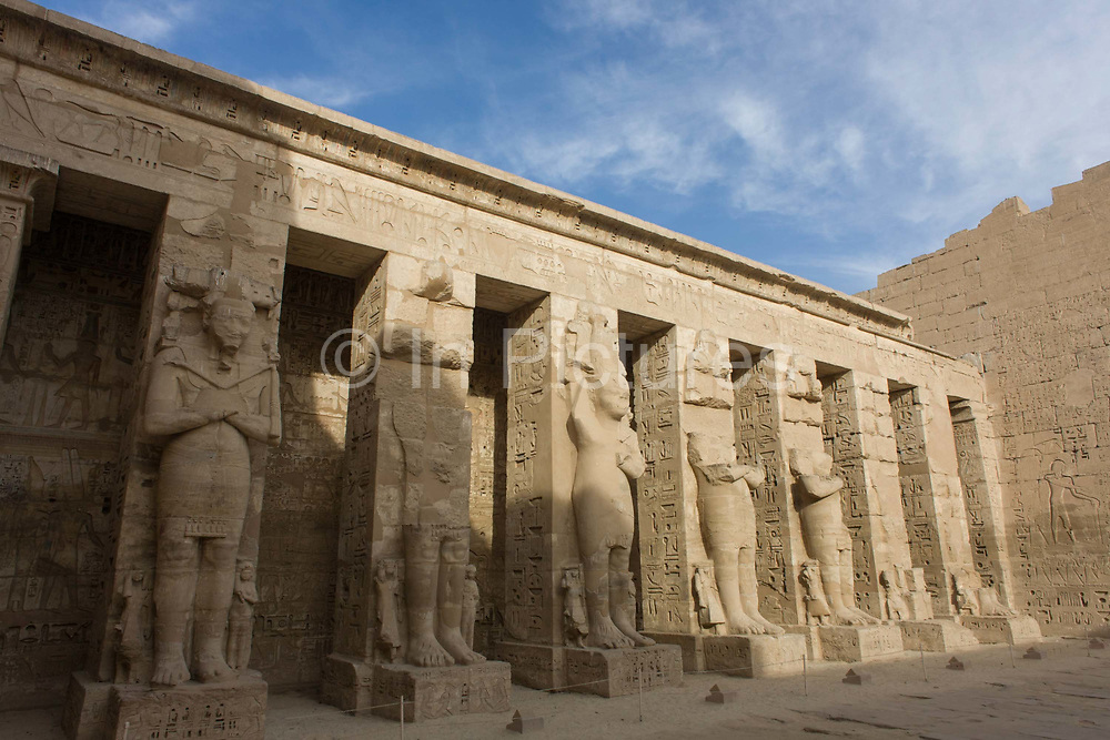 Minus tourists, the tall Ramessid columns in the peristyle court at the ancient Egyptian site of Medinet Habu (1194-1163BC), the Mortuary Temple of Ramesses III in Luxor, Nile Valley, Egypt. Medinet Habu is an important New Kingdom period structure in the West Bank of Luxor in Egypt. Aside from its size and architectural and artistic importance, the temple is probably best known as the source of inscribed reliefs depicting the advent and defeat of the Sea Peoples during the reign of Ramesses III. According to the country's Ministry of Tourism, European visitors to Egypt is down by up to 80% in 2016 from the suspension of flights after the downing of the Russian airliner in Oct 2015. Euro-tourism accounts for 27% of the total flow and in total, tourism accounts for 11.3% of Egypt's GDP.