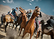 A horse festival taking place near Murghab town, off the Pamir Highway, to try and revive the ancient Kyrgyz horse traditions, many of which have been lost during the Soviet era. Pamir mountains.<br /> <br /> Tajikistan, a mountainous landlocked country in Central Asia. Afghanistan borders it to the south, Uzbekistan to the west, Kyrgyzstan to the north, and People's Republic of China to the east. Tajikistan also lies adjacent to Pakistan separated by the narrow Wakhan Corridor.<br /> Tajikistan became a republic of the Soviet Union in the 20th century, known as the Tajik Soviet Socialist Republic.<br /> It was the first of the Central Asian republic to gain independence in December 1991.
