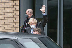Livingston, Scotland, UK. 28 January 2020. Prime Minister Boris Johnson leaves Valneva vaccine production plant in Livingston on his visit to Scotland. The plant has commenced production of vaccines today. One man staged a solo protest against his visit.  Iain Masterton/Alamy Live News