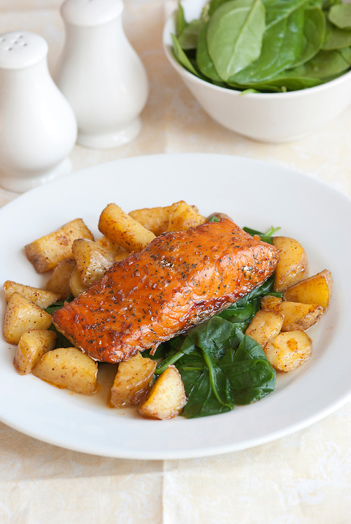 Spice-crusted salmon with roast potatoes and spinach