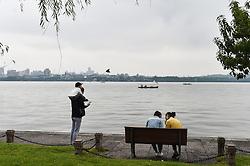 HANGZHOU, Sept. 7, 2016 (Xinhua) -- People enjoy themselves on the Bai Causeway over the West Lake in Hangzhou, capital of east China's Zhejiang Province, Sept. 7, 2016. (Xinhua/Huang Zongzhi) (wf) (Credit Image: © Huang Zongzhi/Xinhua via ZUMA Wire)