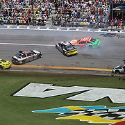 NASCAR Sprint Cup drivers Dale Earnhardt Jr. (88), Danica Patrick (10), Carl Edwards (99), Marcos Ambrose (9), Matt Kenseth (20), Kyle Larson (42), and Denny Hamlin (11) are involved in a crash on the front stretch during the 56th Annual NASCAR Coke Zero 400 race at Daytona International Speedway on Sunday, July 6, 2014 in Daytona Beach, Florida.  (AP Photo/Alex Menendez)