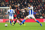 Shane Duffy (4) of Brighton and Hove Albion challenges Lys Mousset (9) of AFC Bournemouth during the The FA Cup 3rd round match between Bournemouth and Brighton and Hove Albion at the Vitality Stadium, Bournemouth, England on 5 January 2019.