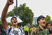 """Passionate Demonstrators shout and chant anti-Taliban slogans during a protest """"Save Afghanistan"""" near Marble Arch in central London against the Taliban on Saturday, Aug 21, 2021. (VX Photo/ Vudi Xhymshiti)"""