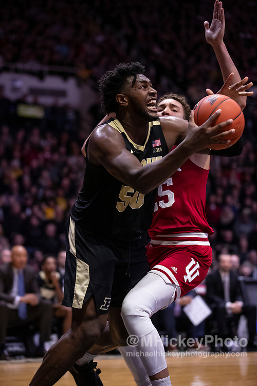 WEST LAFAYETTE, IN - FEBRUARY 27: Trevion Williams #50 of the Purdue Boilermakers makes a move to the basket against Race Thompson #25 of the Indiana Hoosiers during the second half at Mackey Arena on February 27, 2020 in West Lafayette, Indiana.(Photo by Michael Hickey/Getty Images) *** Local Caption *** Trevion Williams; Race Thompson