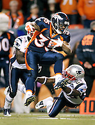 DENVER, CO - DECEMBER 18: Lance Ball #35 of the Denver Broncos tries to hurdle the tackle of Nate Jones #23 of the New England Patriots on December 18, 2011 during the second half at Sports Authority Field at Mile High in Denver, Colorado. The New England Patriots won the game 41-23. (Photo by Marc Piscotty / © 2011)