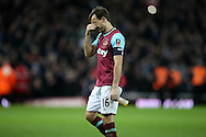 Mark Noble of West Ham United looks dejected as he comes off the pitch after full time. The Emirates FA cup, 6th round replay match, West Ham Utd v Manchester Utd at the Boleyn Ground, Upton Park  in London on Wednesday 13th April 2016.<br /> pic by John Patrick Fletcher, Andrew Orchard sports photography.