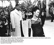 Andre Leon Talley and Lady Amanda Harlech arriving at the Vanity Fair Oscar night party. Mortons. 23 March 1997. film 97732f11<br />© Copyright Photograph by Dafydd Jones<br />66 Stockwell Park Rd. London SW9 0DA<br />Tel 0171 733 0108