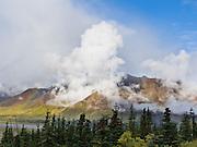 Clouds rise over the Alaska Range in Denali National Park, Alaska, USA.