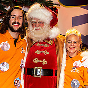 NLD/Hilversum/20141209 - Sky Radio Christmas Tree for Charity 2014, Billy en Ruud van Utopia met de kerstman