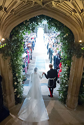 Prince Harry and Meghan Markle leave St George's Chapel at Windsor Castle after their wedding.