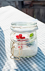 Close-up of currant fruits in jar on dining table, Zillertal, Tyrol, Austria