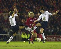 Photo. Glyn Thomas.<br /> Middlesbrough v Tottenham Hotspur.<br /> FA Barclaycard Premiership.<br /> Riverside Stadium, Middlesbrough. 09/03/2004.<br /> Spurs' Michael Brown (L) and Darren Anderton (R) team up to close down Boro's Gaizka Mendieta.