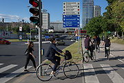 Cyclists ride on Dunajska Cesta in the Slovenian capital, Ljubljana, on 27th June 2018, in Ljubljana, Slovenia. Ljubljana is a small city with flat terrain and a good cycling infrastructure. It was featured at eighth on the Copenhagenize index listing the most bike-friendly cities in the world. A new bike counter on Dunajska Street declares publicly that there are many days with more than 5,000 cyclists who take a trip through there.