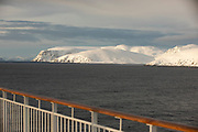 Scenic view of snow-capped mountain range at sunrise, Havoysund, Norway