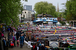 © Licensed to London News Pictures.30/04/2017.London, UK. Narrowboats lined up as the Canalway Cavalcade festival takes place in Little Venice, London on Saturday, 30 April 2017. Inland Waterways Association's annual gathering of canal boats brings around 130 decorated boats together in Little Venice's canals on May bank holiday weekend. Photo credit: Ben Cawthra/LNP