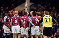 Photo: Alan Crowhurst.<br />Fulham v West Ham United. The Barclays Premiership. 23/12/2006. West Ham's Paul Konchesky (3) is sent off for a challenge on Wayne Routledge by referee Chris Foy.