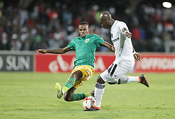 17032018 (Durban) Musa Nyatama of pirates and Mzwandile Buthelezi of Arrows tacke when Orlando Pirates walloped Golden Arrows 2-1 at the ABSA premier league encounter at Princess Magogo Staduim, in Kwa-Mashu, Durban. Pirates has advance their league position to number 2 with 41 points after Sundowns with 42 points lead.<br /> Picture: Motshwari Mofokeng/African New Agency/ANA