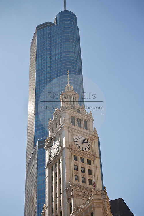 Wrigley building clock tower against the Trump Hotel along Michigan Ave in Chicago, IL, USA.