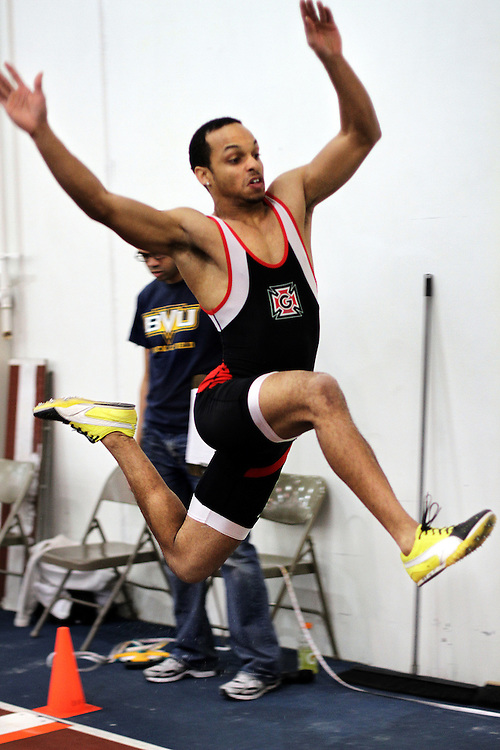 Fonz Jenkins '10 gives a strong stride during the Long Jump competition at the Dennis Young Invitation in Storm Lake, IA. Jenkins went on to place fourth in the Pole Vault competition with a succesful jump of 4.00m.