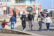 April 6, 2020, London, England, United Kingdom: People enjoy walking beside the Beach in Brighton on Monday, April 6, 2020 - as British Prime Minister Boris Johnson was moved to intensive care after his coronavirus symptoms worsened in London. Johnson was admitted to St Thomas' hospital in central London on Sunday after his coronavirus symptoms persisted for 10 days. Having been in the hospital for tests and observation, his doctors advised that he be admitted to intensive care on Monday evening. The new coronavirus causes mild or moderate symptoms for most people, but for some, especially older adults and people with existing health problems, it can cause more severe illness or death. (Credit Image: © Vedat Xhymshiti/ZUMA Wire)
