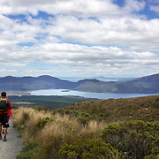 Walkers on the Tangariro Alpine Crossing.  The Tongariro Alpine Crossing is a 7-8 hour hike traversing two active volcanoes within the Tongariro National Park, North Island, New Zealand.  It is considered to be the best one day hike in New Zealand and in the top 10 one day hikes in the world. Packed into the 19.4km hike is an array of diverse landscapes and vegetations. From tussock like alpine meadows, to rugged lava flows, desert like craters and emerald lakes 9th January 2011. Photo Tim Clayton..
