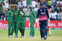 Pakistan's Sarfraz Ahmed (3rd left) celebrates the wicket of England's Joe Root (right) with teammates during the ICC Champions Trophy, semi-final match at the Cardiff Wales Stadium.